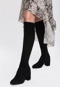 Renee - Czarne Kozaki Pyrmont. Nosek buta: okrągły. Zapięcie: zamek. Kolor: czarny. Szerokość cholewki: normalna. Wzór: aplikacja. Sezon: jesień, zima. Obcas: na słupku