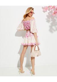 CHIO - Spódnica mini z kwiatowym nadrukiem. Stan: podwyższony. Kolor: beżowy. Materiał: materiał, koronka. Wzór: kwiaty, nadruk