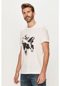 Biały t-shirt Puma z nadrukiem, casualowy, z okrągłym kołnierzem, na co dzień