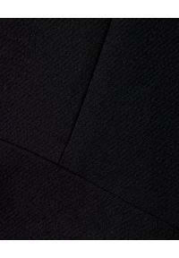 VALENTINO - Czarna rozkloszowana sukienka. Kolor: czarny. Materiał: jedwab, wełna. Typ sukienki: dopasowane, rozkloszowane. Styl: klasyczny, elegancki. Długość: mini