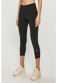 Nike - Legginsy. Kolor: czarny. Materiał: tkanina, dzianina, skóra, włókno. Technologia: Dri-Fit (Nike). Wzór: gładki