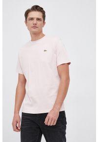 Lacoste - T-shirt bawełniany. Okazja: na co dzień. Kolor: różowy. Materiał: bawełna. Wzór: aplikacja. Styl: casual