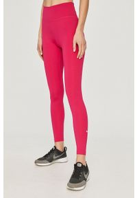 Nike - Legginsy. Stan: podwyższony. Kolor: różowy. Materiał: włókno, skóra, tkanina. Technologia: Dri-Fit (Nike)