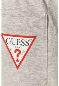 Guess - Spodnie. Kolor: szary. Materiał: dzianina. Wzór: gładki