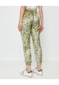 THECADESS - Limonkowe spodnie w tygrysy Baltic. Kolor: zielony. Materiał: materiał, guma. Długość: długie. Wzór: nadruk
