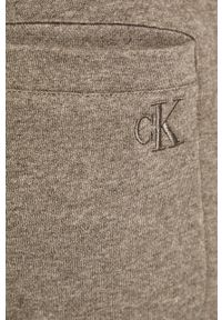 Szare spodnie dresowe Calvin Klein Jeans melanż