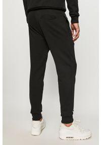 Czarne spodnie dresowe Diadora z nadrukiem