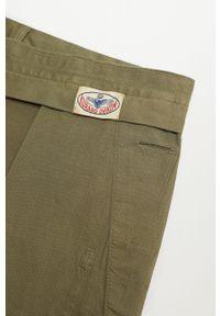 Mango Man - Spodnie BARNA. Kolor: brązowy, wielokolorowy, złoty. Materiał: elastan, tkanina, materiał, bawełna. Wzór: gładki #7