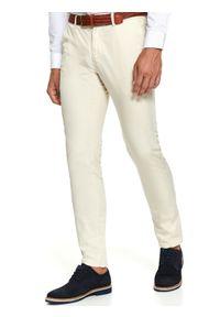 Beżowe spodnie TOP SECRET w kolorowe wzory, klasyczne, na jesień