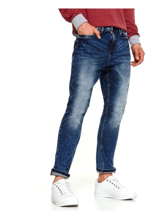 Niebieskie spodnie TOP SECRET na zimę, eleganckie, w kolorowe wzory, na co dzień