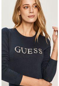Niebieski sweter Guess Jeans z długim rękawem, długi, z aplikacjami