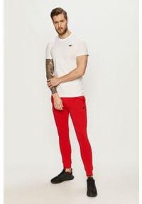 Czerwone spodnie dresowe 4f gładkie