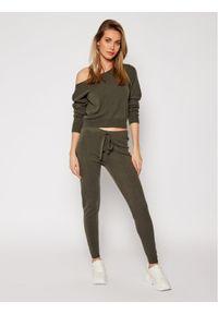 Zielone spodnie dresowe Guess