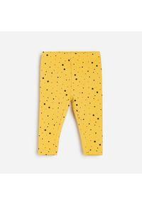 Żółte spodnie Reserved w kropki
