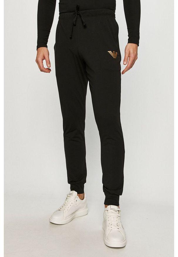 Czarne spodnie dresowe Emporio Armani z nadrukiem
