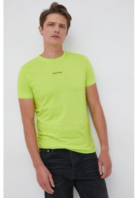 Calvin Klein Jeans - T-shirt. Okazja: na co dzień. Kolor: zielony. Materiał: bawełna, dzianina. Wzór: gładki. Styl: casual