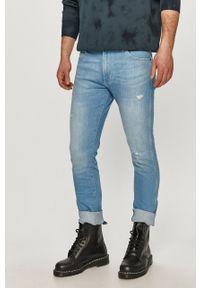 Niebieskie jeansy Wrangler gładkie