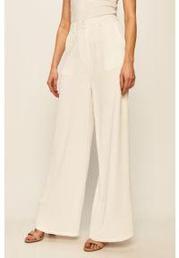 Białe spodnie materiałowe Glamorous