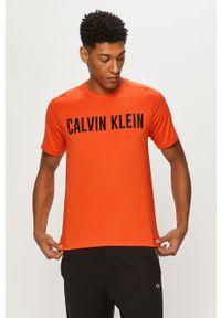 Pomarańczowy t-shirt Calvin Klein Performance z nadrukiem, casualowy, na co dzień