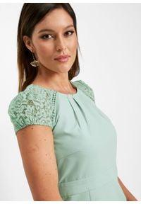 Sukienka ołówkowa z rękawami koronkowymi bonprix kryształowy miętowy. Kolor: zielony. Materiał: koronka. Typ sukienki: ołówkowe. Styl: elegancki