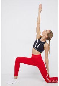 Calvin Klein Performance - Legginsy. Kolor: czerwony. Materiał: materiał