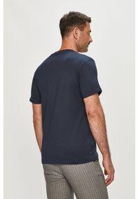 Guess - T-shirt. Okazja: na co dzień. Kolor: niebieski. Wzór: nadruk. Styl: casual