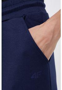 4f - 4F - Spodnie. Kolor: niebieski. Materiał: dzianina. Wzór: gładki