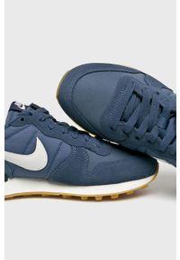 Niebieskie buty sportowe Nike Sportswear na sznurówki, z cholewką