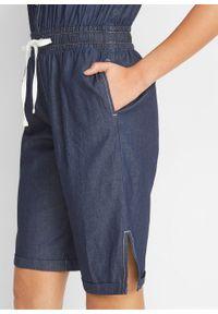"""Kombinezon dżinsowy bawełniany, z szerokim wygodnym paskiem bonprix ciemnoniebieski """"stone"""". Kolor: niebieski. Materiał: bawełna"""