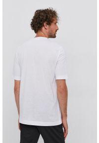 Calvin Klein Jeans - T-shirt bawełniany. Okazja: na co dzień. Kolor: biały. Materiał: bawełna. Wzór: gładki. Styl: casual