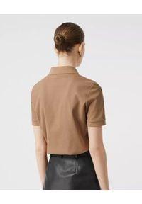 Burberry - BURBERRY - Beżowa koszulka polo. Typ kołnierza: polo. Kolor: beżowy. Materiał: elastan, bawełna. Wzór: haft. Styl: klasyczny, elegancki, rockowy