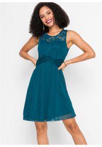 Zielona sukienka bonprix w koronkowe wzory