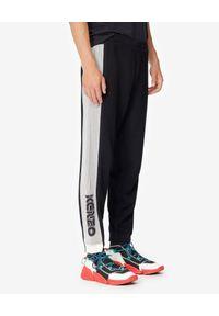 Kenzo - KENZO - Spodnie jogger z łączonych materiałów. Kolor: czarny. Materiał: materiał. Wzór: aplikacja