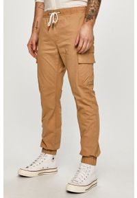 Tommy Jeans - Spodnie. Okazja: na co dzień. Kolor: beżowy. Materiał: tkanina. Wzór: gładki. Styl: casual