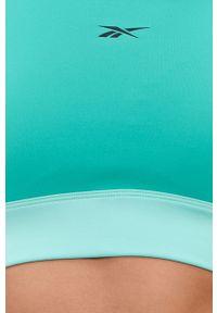 Reebok - Biustonosz. Kolor: zielony. Materiał: skóra. Rodzaj stanika: odpinane ramiączka