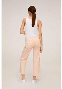 Różowe jeansy mango