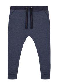 Niebieskie spodnie dresowe Primigi