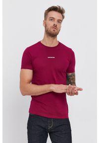 Calvin Klein Jeans - T-shirt. Okazja: na co dzień. Kolor: fioletowy. Materiał: bawełna, dzianina. Wzór: gładki. Styl: casual