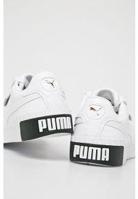 Białe buty sportowe Puma na sznurówki, na średnim obcasie