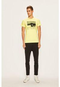 Żółty t-shirt Diesel casualowy, z nadrukiem, na co dzień