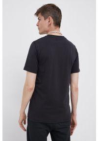 New Balance - T-shirt. Okazja: na co dzień. Kolor: czarny. Wzór: nadruk. Styl: casual