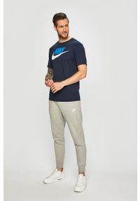 Nike Sportswear - Spodnie. Kolor: szary. Materiał: dzianina. Wzór: gładki