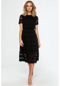 e-margeritka - Koronkowa elegancka sukienka midi czarna - xl. Kolor: czarny. Materiał: koronka. Wzór: koronka. Styl: elegancki. Długość: midi