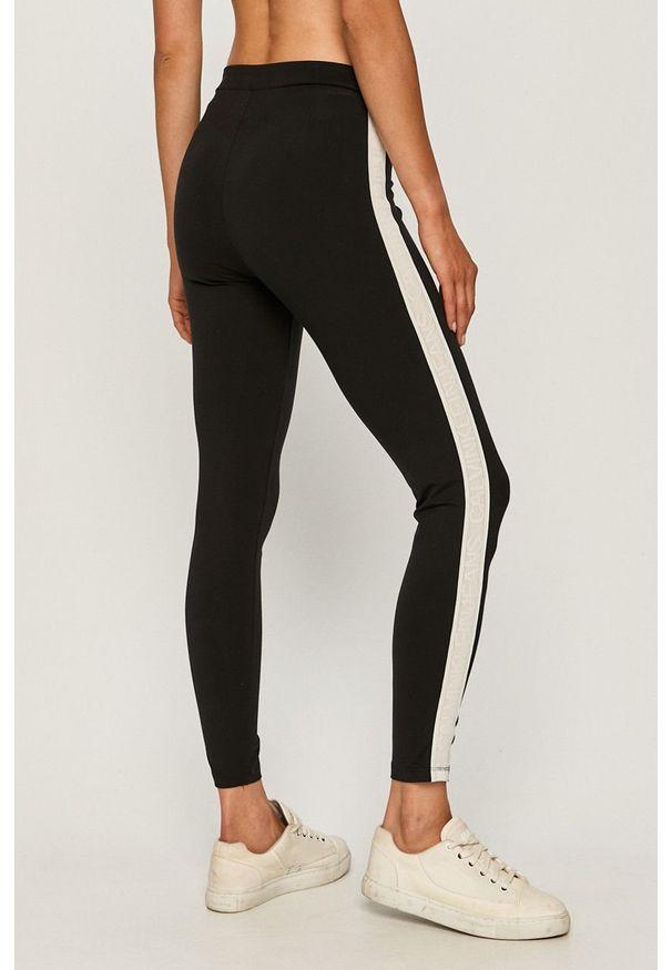 Czarne legginsy sportowe Calvin Klein Jeans z aplikacjami
