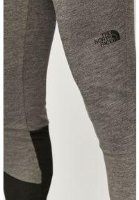 Szare legginsy sportowe The North Face z aplikacjami