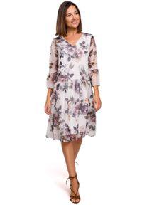 MOE - Biała Kobieca Sukienka w Kwiaty z Obniżoną Talią. Kolor: biały. Materiał: poliester. Wzór: kwiaty