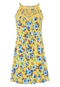 Sukienka z szydełkową wstawką bonprix żółty w kwiaty. Kolor: żółty. Wzór: kwiaty. Długość: mini