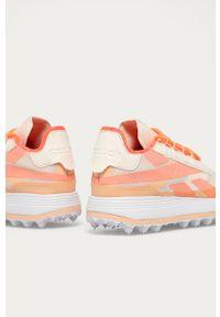Pomarańczowe buty sportowe Reebok Classic z cholewką, na sznurówki, na obcasie, na niskim obcasie