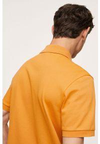 Mango Man - Polo Rea. Okazja: na co dzień. Typ kołnierza: polo. Kolor: pomarańczowy. Materiał: skóra, materiał. Długość: krótkie. Styl: casual