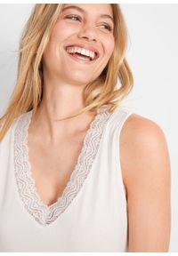 Top z ażurową koronką bonprix biel wełny. Kolor: biały. Materiał: wełna, elastan, koronka, materiał, bawełna. Wzór: ażurowy, koronka